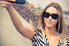 Girl making selfie Royalty Free Stock Photography