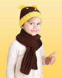 Girl making sign 'OK'. Young girl wearing warm clothes making sign 'OK' with her thumb Stock Image