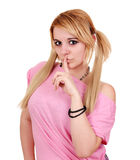 Girl making silence gesture. Teenage girl making silence gesture Royalty Free Stock Photography