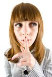 Girl making silence sign Stock Photography
