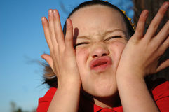 Girl making a silly face. Humorous portrait of child making a face Stock Image