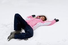 Girl making snow angel Royalty Free Stock Images