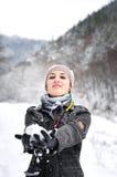 Girl making snowball Royalty Free Stock Photography
