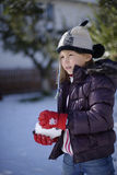 Girl making snowball Royalty Free Stock Photography