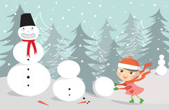 Girl making snowman Royalty Free Stock Images