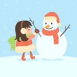 Girl is making a snowman Royalty Free Stock Photos