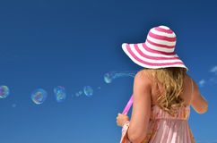 Girl making soap bubbles Royalty Free Stock Images