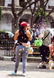 Girl making soap bubbles on market in Guatemala Royalty Free Stock Photo