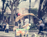 Girl making soap bubbles on market in Guatemala Royalty Free Stock Photography