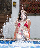 Girl making splash with water Royalty Free Stock Photography