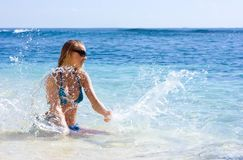 Girl making splashes in the sea Royalty Free Stock Images