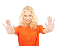 Girl making stop gesture Stock Photo