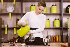 The girl is making tea in a cafe Stock Photos