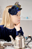 Girl making tea Royalty Free Stock Images