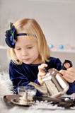Girl making tea Royalty Free Stock Image