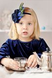 Girl making tea Stock Image