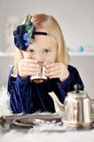 Girl making tea Stock Images