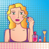 Girl making up Stock Photography