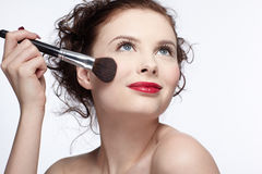 Girl making up Stock Images