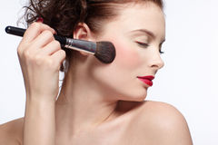 Girl making up Stock Photos