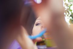 Girl making up Royalty Free Stock Images