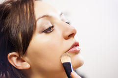 Girl making up Stock Image