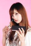 Girl making up. Stock Photos