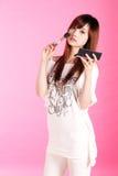 Girl making up. A beautiful Asian girl making up Royalty Free Stock Image