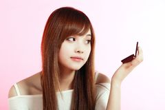 Girl making up. Royalty Free Stock Photos