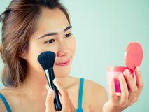 Girl making up with blush Stock Photography
