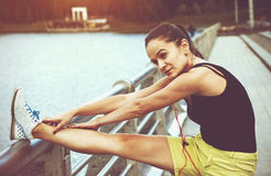 Girl making warm-up stretching legs Royalty Free Stock Image