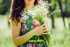 Girl making wildflower bouquet Stock Images
