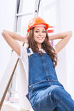 Girl in male role is resting at the worksite Stock Photography
