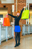 Girl in the mall with shopping bags Royalty Free Stock Image