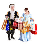 Girl and man in ancient dress, shopping bag. Royalty Free Stock Photo