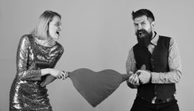 Girl and man with angry faces play with toy heart royalty free stock photography