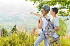 Girl and man with backpack in mountain. Stock Photography