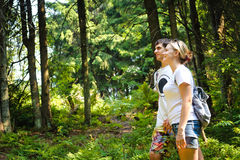 Girl and man with backpack in mountain. Royalty Free Stock Photos