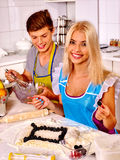 Girl and man baking cookies in oven Royalty Free Stock Photography