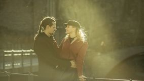 Girl and man on the bridge,  cute relationships Stock Photography