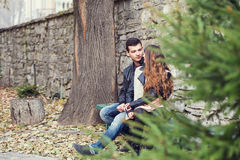 Girl man couple sitting autumn park Royalty Free Stock Images