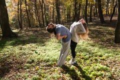 Girl and man doing yoga Royalty Free Stock Image