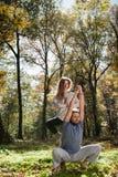 Girl and man doing yoga Stock Photo