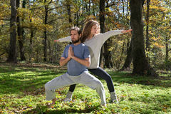 Girl and man doing yoga meditation Royalty Free Stock Photos