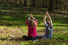Girl and man doing yoga meditation Stock Photography