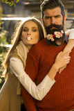 Girl and man with flowers on beard Stock Photography