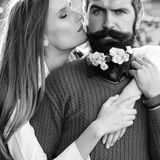 Girl and man with flowers on beard Royalty Free Stock Images