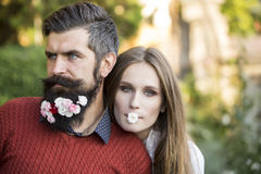 Girl and man with flowers on beard Stock Photo