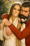 Girl and man with flowers on beard Stock Images