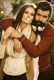 Girl and man with flowers on beard Royalty Free Stock Photo